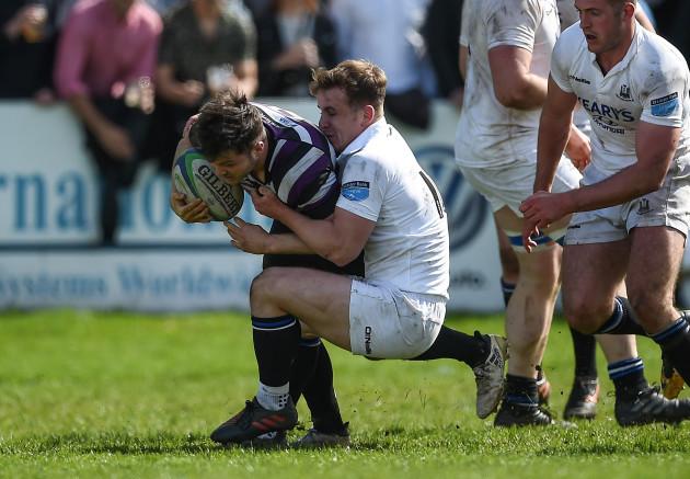 Sam Coghlan Murray is tackled by Rob Jermyn
