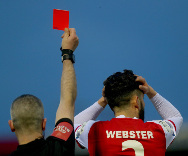 David Webster reacts after receiving a red card from Sean Grant