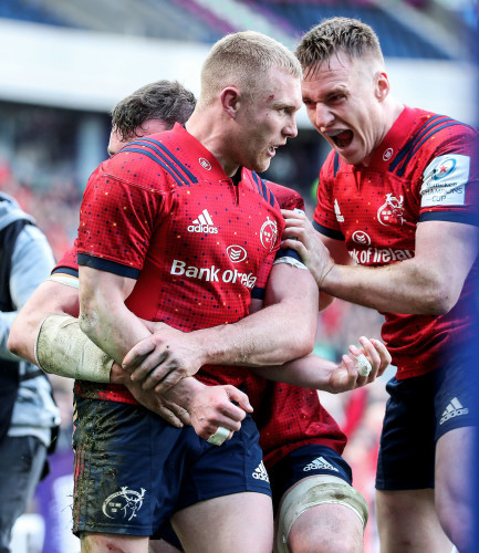 Keith Earls celebrates his second try with Peter O'Mahony and Rory Scannell