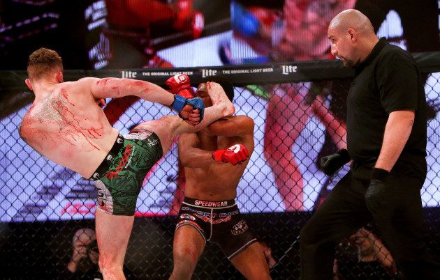 Brian Moore lands a kick on AJ McKee