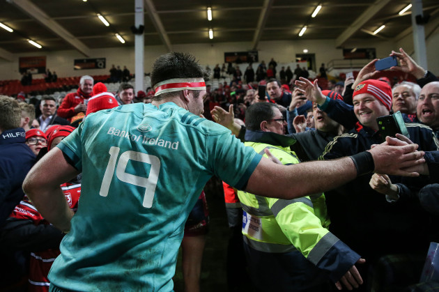 Billy Holland celebrates with fans after the game