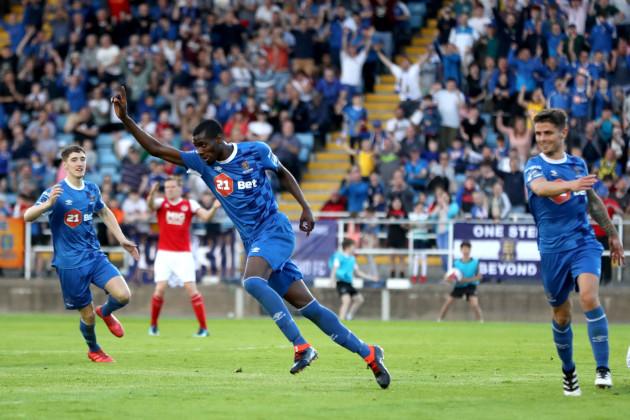 Izzy Akinade celebrates scoring a goal