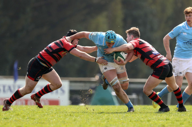 Kevin Seymour is tackled by Andrew Smyth and Chris Colvin