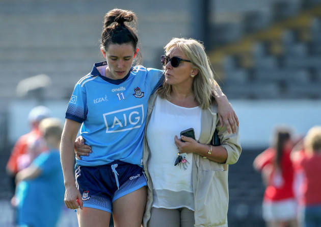 A dejected Niamh McEvoy of Dublin is comforted by her mother Joan end of the game