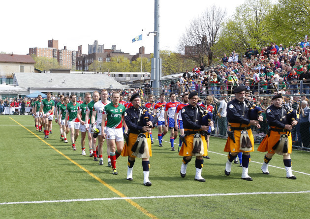 The Mayo and New York teams parade before the game