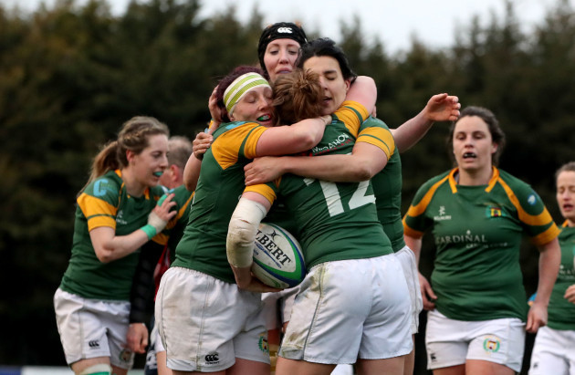 Meg Kendal celebrates scoring a try with team mates