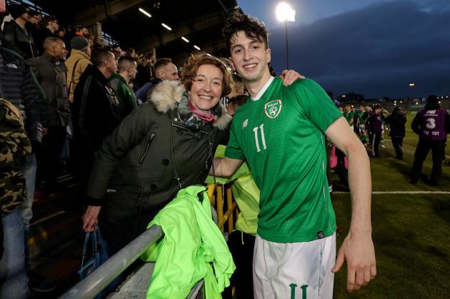 Neil Farrugia celebrates with Mary Farugia after the game