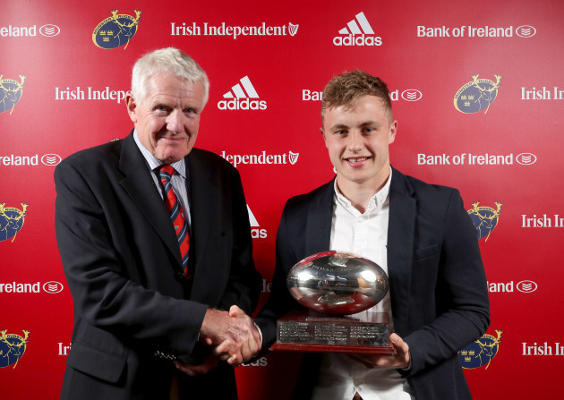 Craig Casey is presented with the John McCarthy award for Greencore Munster Academy Player of the Year from Dr. Paul McCarthy