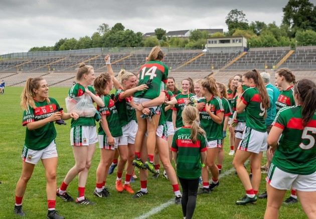 Sarah Rowe celebrates with team mates after the game