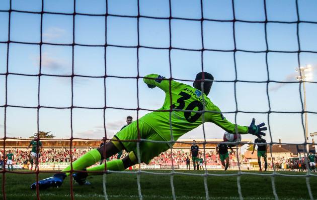 Gavin Bazunu saves a penalty from Kieran Sadlier