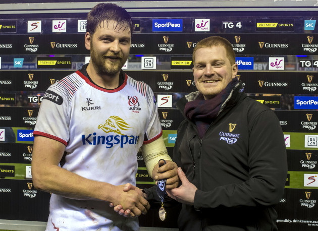 Iain Henderson is presented with the Guinness PRO14 Man of the Match award by Ryan Ewing
