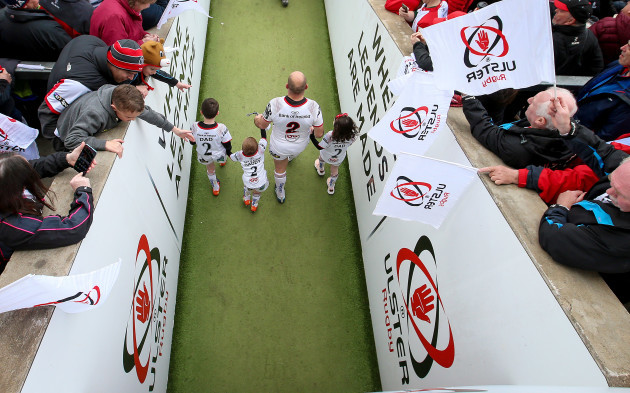Rory Best leads his team out with his children