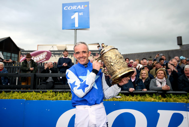 Ruby Walsh celebrates with the Coral Punchestown Gold Cup after winning with Kemboy