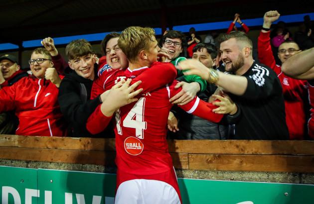 Kris Twardek celebrates with fans