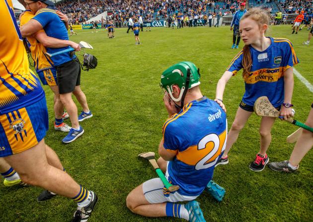 A young fan consoles Noel McGrath