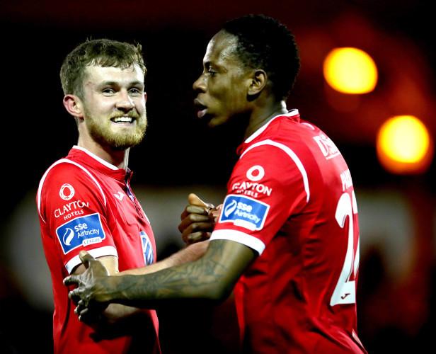Lewis Banks and Romeo Parkes celebrate