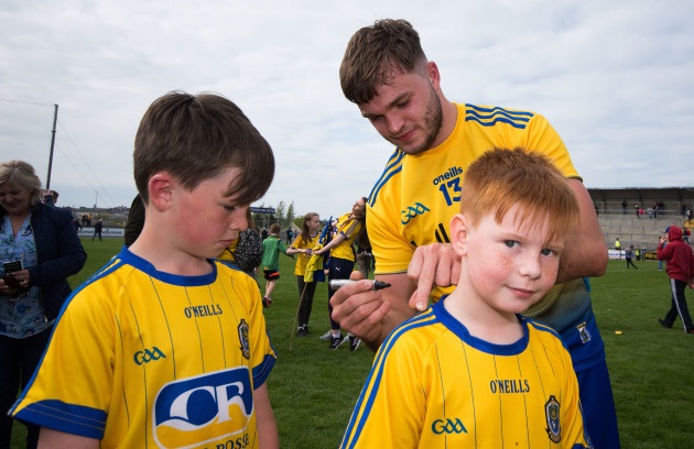 Ultan Harney signs jerseys for young supporters