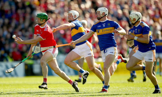 Seamus Harnedy tackled by Padraic Maher and Michael Breen