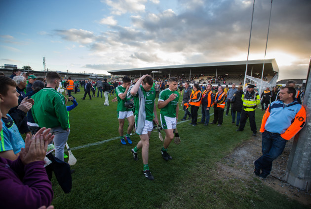 Limerick supporters applaud their players