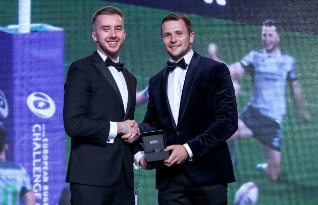 Shane Gubbins presents the award to Jack Carty
