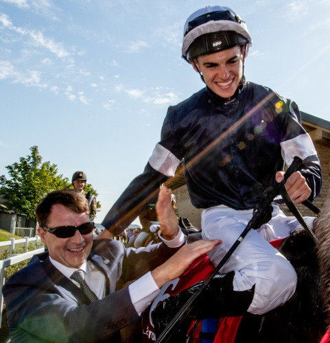 Donnacha O'Brien on Latrobe celebrates winning The Dubai Duty Free Irish Derby with his father Aidan O'Brien