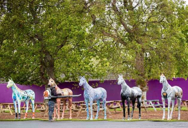 Leopardstown staff put the finishing touches to some ornamental horses