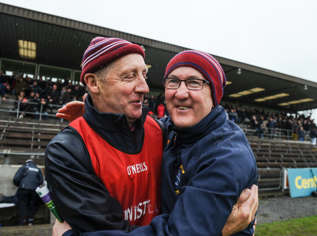 Michael Ryan and Michael Walsh celebrate at the end of the game