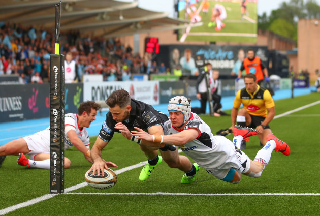 Tommy Seymour scores a try despite Michael Lowry