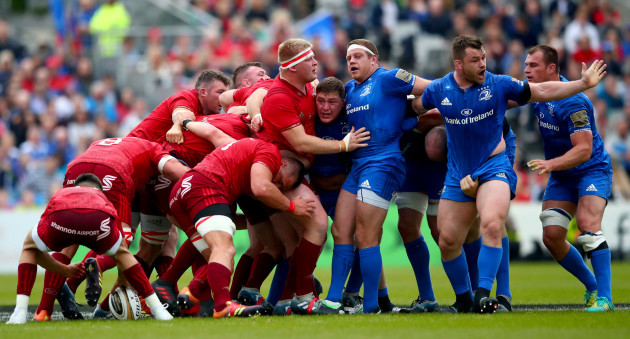 Tadhg Furlong, Sean Cronin and Cian Healy argue as Munster win a scrum penalty
