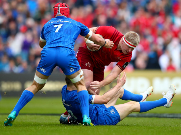 Josh van der Flier and Garry Ringrose tackle John Ryan