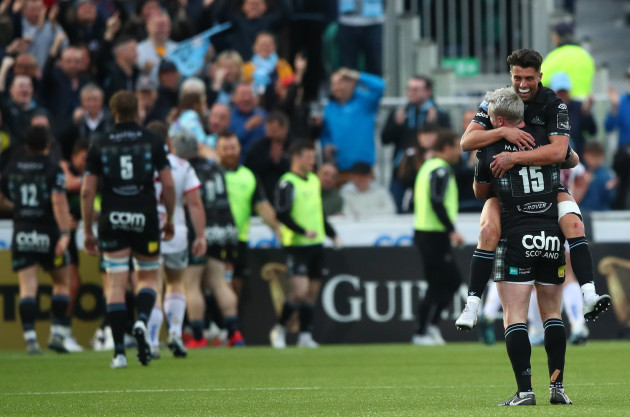Adam Hastings and Stuart Hogg celebrate after Kyle Steyn scored their sides fifth try