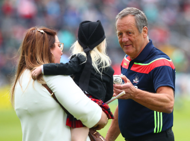 John Meyler gives a little girl a sliotar before the game after she was accidentally knocked over by a player