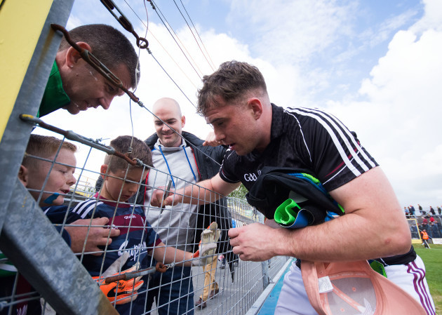 Bernard Power signs shirts for some young supporters