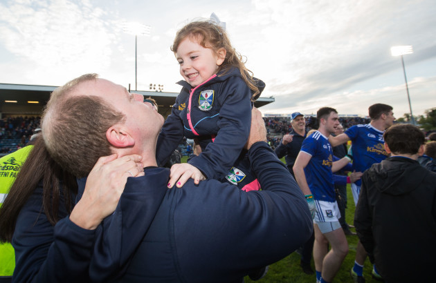 Mickey Graham celebrates after the game with his daughter Lauren