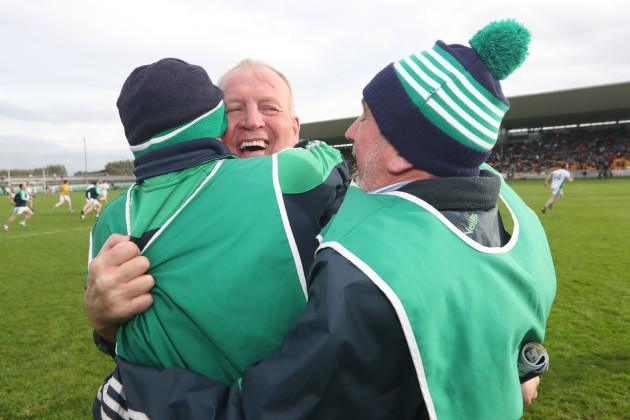Joachim Kelly celebrates after the game with with his management team