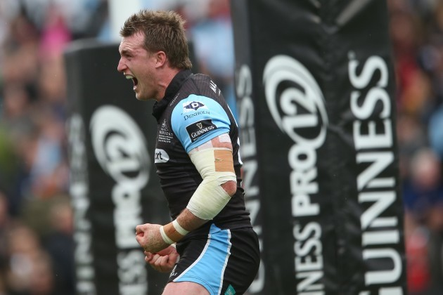 Stuart Hogg celebrates scoring a try