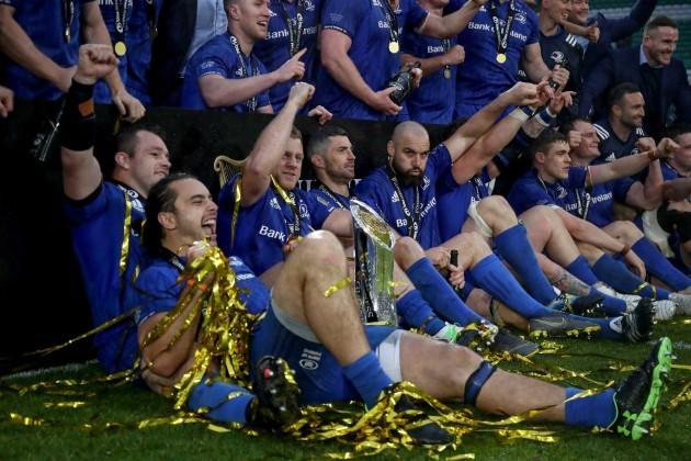 James Lowe and Cian Healy celebrate with teammates after winning the Guinness PRO14 Final