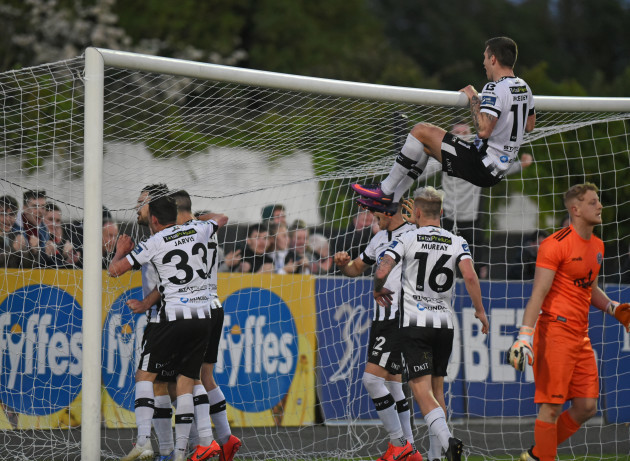 Dundalk players celebrate Patrick HobanÕs winning penalty in extra time