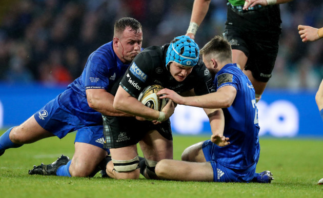 Glasgow Warrior's Scott Cummings is tackled by Leinster's Bryan Byrne and Ross Byrne