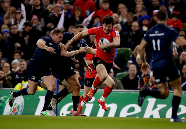 Ulster's Jacob Stockdale chased by Leinster's Sean Cronin and Adam Byrne
