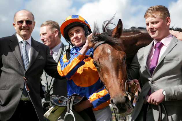 Michael Tabor and Ryan Lee Moore with Hermosa after winning The Tattersalls Irish 1,000 Guineas