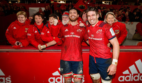 Billy Holland celebrates after the game with the choir and Jean Kleyn