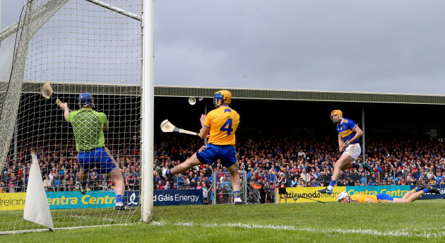 Seamus Callanan scores his sides second goal despite goalkeeper Donal Tuohy, Seadna Morey and Patrick O'Connor