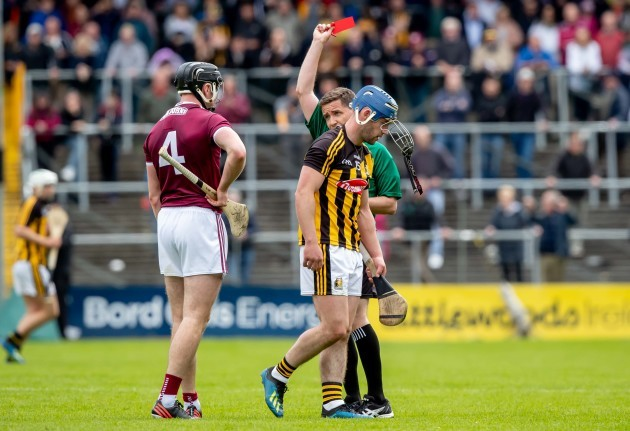 Ger Aylward is shown a red card by referee Colm Lyons
