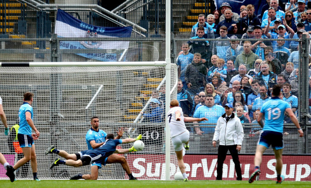Stephen Cluxton saves a shot from Keith Cribbin