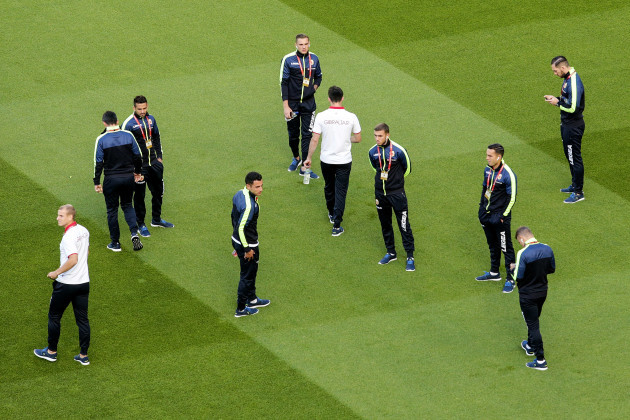Gibraltar players inspect the pitch ahead of the game