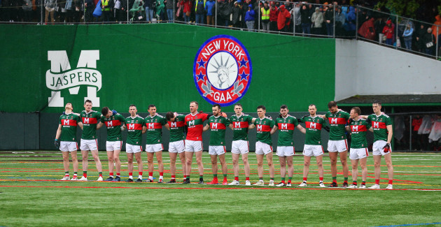 The Mayo team stand for a minutes silence