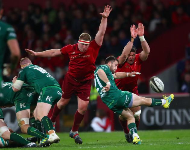 Caolin Bladen under pressure from John Ryan and Billy Holland