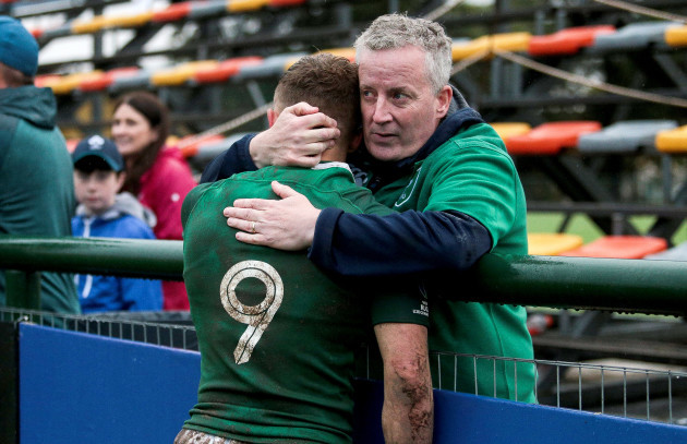 Craig Casey is consoled by his father after the game