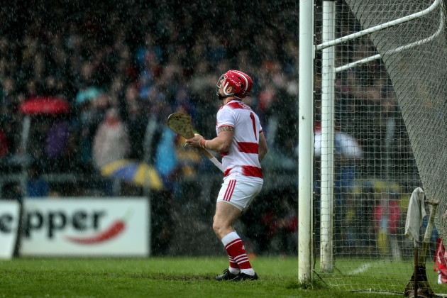 Anthony Nash looks on in the rain